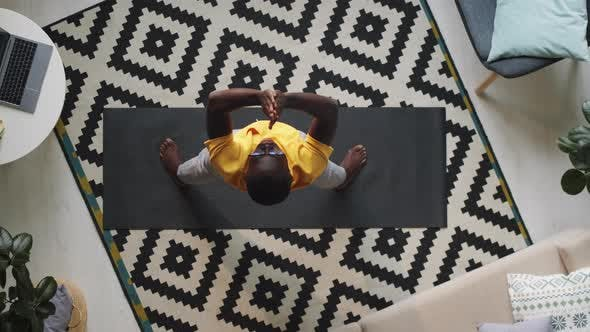 Black Man Exercising at Home