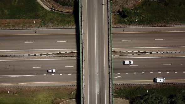 Thumbnail for Directly Above View of Highway Intersection Car Bridge and Moving Cars
