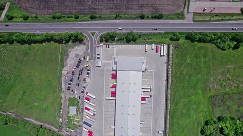 Aerial Top View of a of Semitrailer Truck Traveling Through the Parking