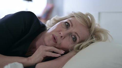 Old Woman Having Nightmare in Bed