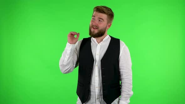 Man Talking and Pointing Side Hand for Something, with Copy Space. Green Screen
