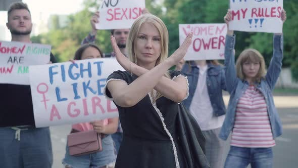 Thumbnail for Confident Caucasian Woman Crossing Hands in No Gesture on Demonstration Against Sexism and Women