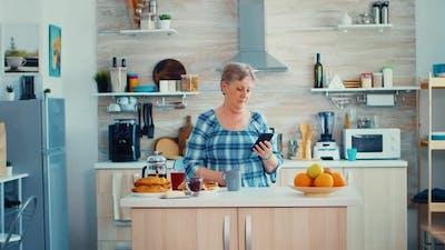 Senior Woman Browsing on Mobile