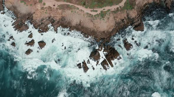 Thumbnail for White Waves Are Crashing Over Sharp Cliffs, Scenic Top Down View on Coastline