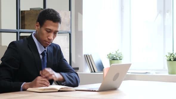 Thumbnail for Black Businessman Reading Book