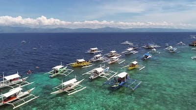 Aerial view of white traditional filipino boats near Panglao, Philippines.