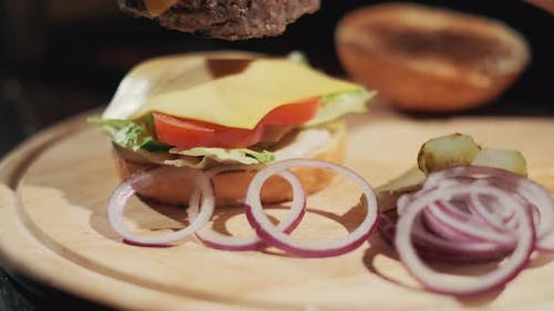 Hands Of Chef Making Burger. Slow Motion