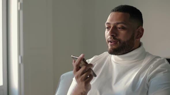 Thumbnail for Confident Latin Guy Speaking on Cell Via Loudspeaker