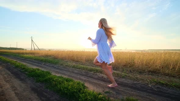 Thumbnail for Beauty Girl Running on Yellow Wheat Field. Freedom Concept. Happy Woman Outdoors. Harvest.