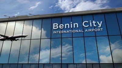 Airplane landing at Benin Nigeria airport mirrored in terminal