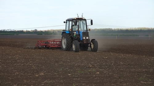 Tractor plows the farm field