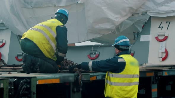 Thumbnail for Cargo Shipping - Men Workers Fasten the Load on the Truck