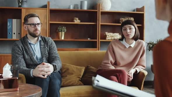 Annoyed Couple Complaining to Female Counselor during Consultation