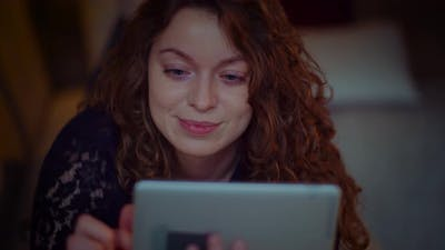 Portrait of Young Female Shopping Online