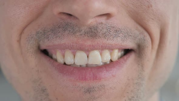 Thumbnail for Close Up of Smiling Lips and Teeth of Gray Hair Man