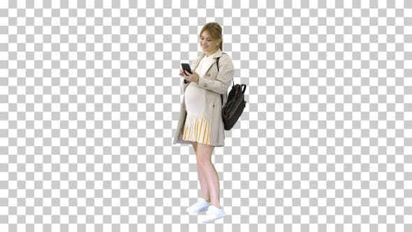 Pregnant casual woman holding cellphone, Alpha Channel