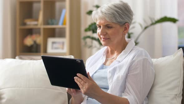 Thumbnail for Happy Senior Woman with Tablet Pc at Home