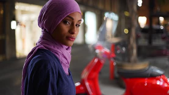 Thumbnail for Young beautiful Muslim woman in the city posing for a portrait