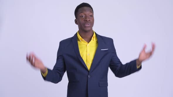 Young Happy African Businessman in Suit Explaining Something
