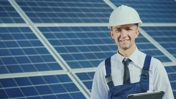 Thumbnail for Portrait of a Successful Young Engineer on the Background of a Solar Power Station