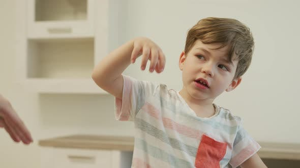 Cover Image for Little boy gesturing
