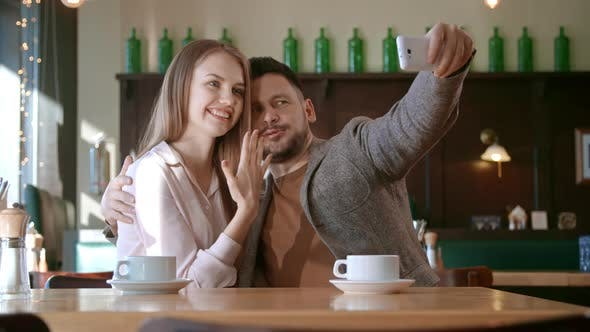 Thumbnail for Engaged Woman Posing for Selfie with Boyfriend
