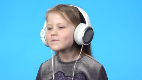 Little Girl Smiling, Listening To the Music, Nodding Her Head
