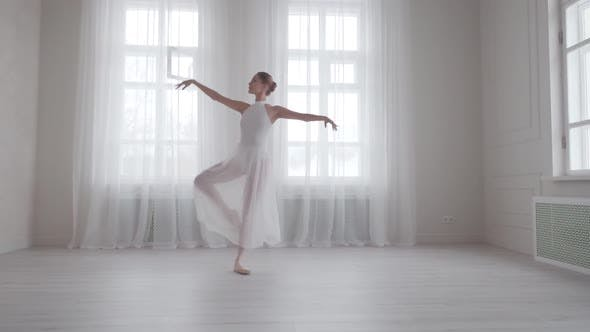 Thumbnail for Graceful Girl Dancing Classical Ballet in a Bright Hall