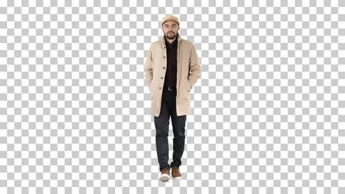 Confident handsome young man wearing coat walking, Alpha Channel