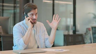 Man Talking on Phone