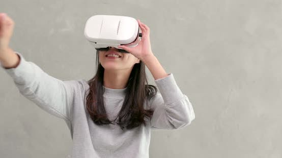 Woman Playing Game with Vr Device