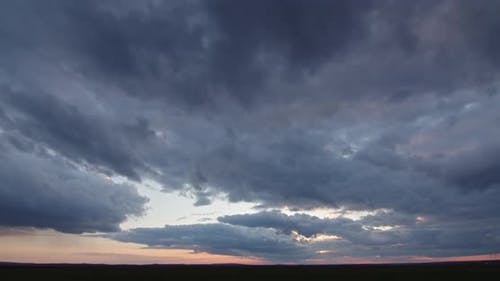 Gloomy Clouds At Sunset, Stormy. Timelapse