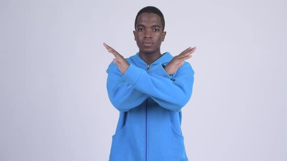 Cover Image for Young Serious African Man with Stop Gesture Using Arms