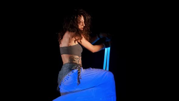 Thumbnail for Beautiful Gipsy Woman Dancing In Neon Light With Ultraviolet Staffs 10