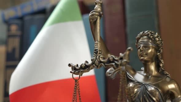 Thumbnail for Statue of Lady Justice with Bookshelf with Books and Italy Flag Background