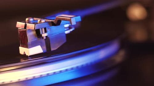 Cinemagraph loop vinyl record player turntable with it's stylus running along music plate.