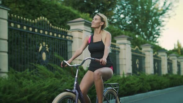 Thumbnail for Happy Woman Cycling Bicycle in City Park. Fit Girl Training on Bike at Summer
