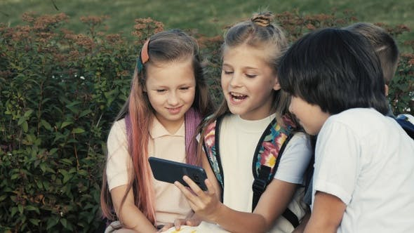 Thumbnail for Happy kids enjoying video on the phone