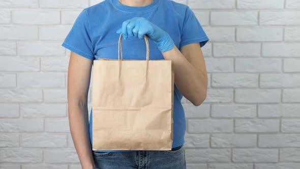 Volunteer with Bag in Quarantine