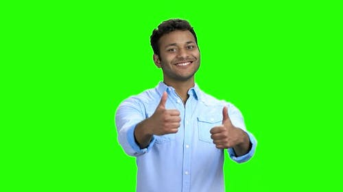 Cheerful Indian Guy Giving Two Thumbs Up
