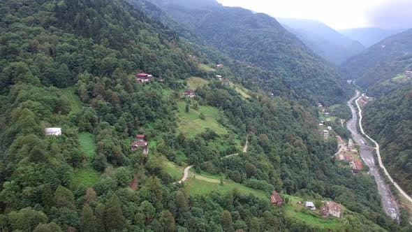 Wooden Traditional Architecture Village Houses in the Forest on the Mountain and Deep Valley