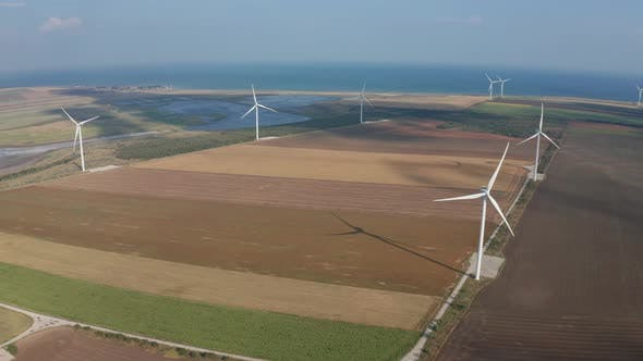 Aerial Shot of Wind Generators Among Arable Land