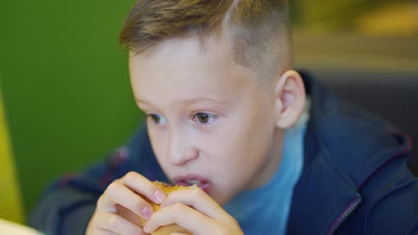 Thumbnail for Young Teenager Eating Tasty Hamburger