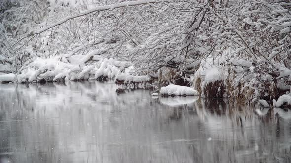 River Coast Covered with White Snow