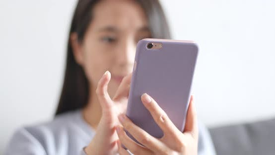Cover Image for Woman using mobile phone at home
