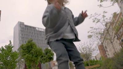 Infant Girl Jumping on Trampoline
