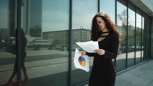 Thumbnail for Closeup Woman Entrepreneur Walking at Street. Woman Reading Documents Outdoors