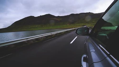 Woman Tourist Travel By SUV Car in Iceland