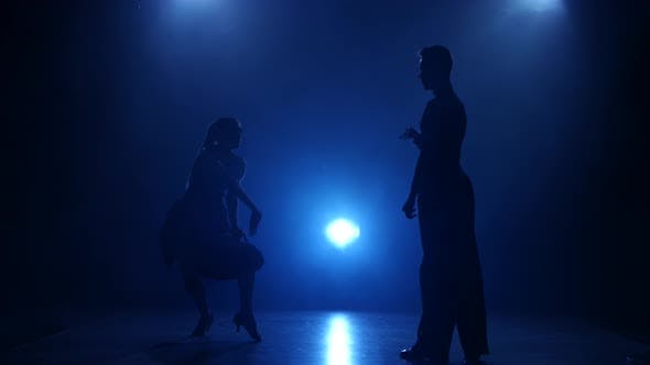Thumbnail for Silhouette of Pair Dancers Performing Latino Dance in Smoky Studio