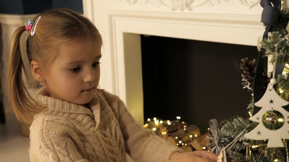 Thumbnail for Children and Christmas. Child at Christmas. Decorating